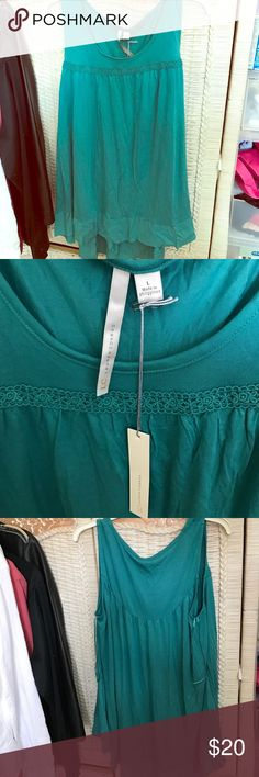 """Brand New!!!! Lauren Conrad high-low tank top Cute sea green high/low tank top with ruffle edge. Soft material, embroidered design across the front. Back long enough to cover some """"assets"""". BRAND NEW and with tags! LC Lauren Conrad Tops Tank Tops"""