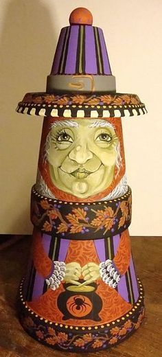 Berry Witched - Not all witches are wicked or drab. This one chooses the colors of Autumn, purples and orange, accessorized with a garland of fall leaves and berries. She's made with stacked terra cotta pots and painted with acryllic guache. Clay Pot Projects, Clay Pot Crafts, Painted Clay Pots, Painted Flower Pots, Tole Painting, Diy Painting, Fall Halloween, Halloween Crafts, Flower Pot People