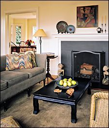 We have blackboard slate at our ReStore!  Old blackboard-slate creates a fireplace surround and refinished plaster walls emphasize the clean, classic lines of the living room.