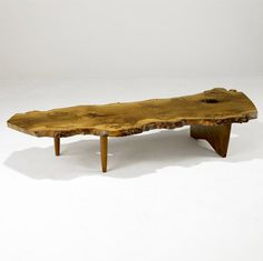 George Nakashima Coffee Table...very similar to one my family had growing up that we sold at auction
