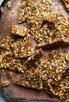 "Pine Nut Brittle Recipe (This pine nut brittle recipe comes together in just 30 minutes and makes a salty sweet crunchy nutty buttery confection that folks are calling ""The best thing to have hanging around over the holidays. Candy Recipes, Dessert Recipes, Desserts, Flan, Meringue, Mousse, Brittle Recipes, Cheesecake, Candied Nuts"