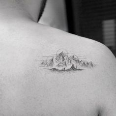 shoulder blade tattoo mountains