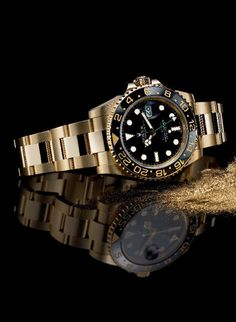 An exceptional example of a Rolex GMT-Master II in 18 ct yellow gold, with a black Cerachrom bezel in ceramic, a black dial and secured with a solid gold Oyster bracelet.