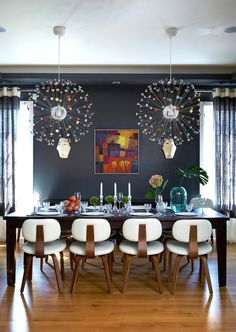 Gus* Modern   A fun dining room setup by Gregory Roth Design. Our bright Thompson Chairs really stand out against the dark walls and dark dining room table.   Thompson Chairs - http://www.gusmodern.com/products1/dining/thompson-chair/thompson-chair.shtml#thompson-chair