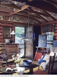 LIVING ROOM - Sitting area, log cabin interior. Norwegian rosemaling, rustic, beams, hanging candle chandelier