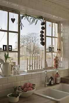 kitchen window - mine is not this cool w/panes and such but I love all the stuff on the sill and hanging.