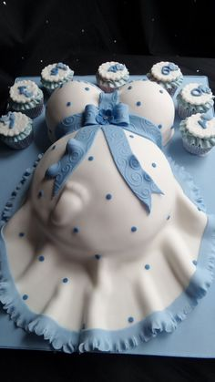Baby Bump baby shower cake in blue and white