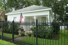 717 E 21st St. - Charming Victorian cottage in the Heights. Oversize lot is 9322 sq ft. Lot is fully fenced, with wrought iron fencing and driveway gate at front.