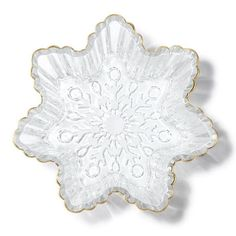 Shine and dine. Serve up something sweet with this festive table accessory.FEATURES• Snowflake shaped dish• Goldtone accent on rimMATERIALS• GlassCAREWipe clean.Made in China