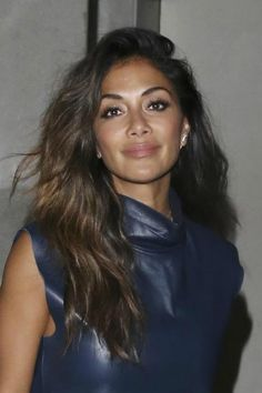 Nicole Scherzinger looked her usual stylish and gorgeous self as she stepped out in a dark blue leather mini dress with a thigh skimming hemline, which showed off her long legs to perfection and a lower body hugging design, which emphasized her pert bottom, while leaving The Ivy Nightclub on West Street, London on August 26, 2016.