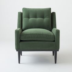 Typified by a thoroughly modern but understated elegance, the Jack Chair has a presence that defies its low-profile stature. A faithful reproduction of a vintage piece we fell in love with while antiquing, every detail – from the splayed hardwood legs and low-slung arms to the subtly tufted cushion – is an ode to mid-century design. With a solid wood frame and plush cushioning, this chair is an effortless and comfortable addition to any interior.  This handcrafted armchair is available in a…