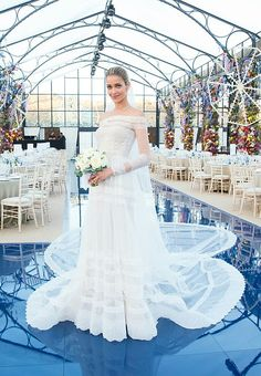 For her wedding day, Ana Beatriz Barros looked resplendent in a custom Valentino gown — a sheer design featuring dainty bands of lace and an elaborate train.