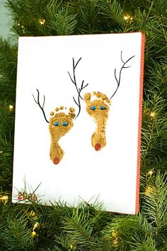 Footprint keepsake craft. Reindeer feet on canvas.