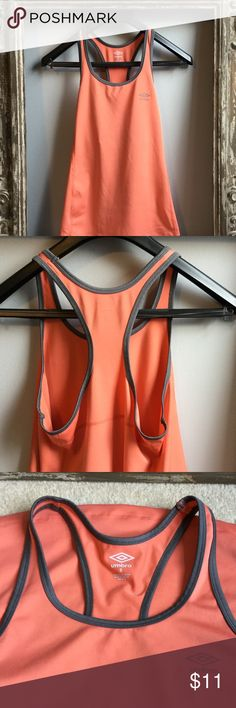 Umbro small peach workout tank❤️ Umbro size small workout tank with gray trim on neck and arms. 26 inches from top of shoulder to bottom of rounded hem. Tops Tank Tops