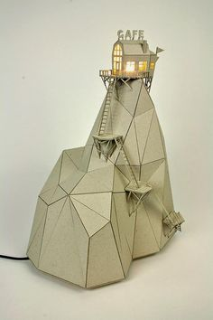 Usually cardboard is something you'd throw away after use, though Dutch artist Vera van Wolferen recycles cardboard, using it as material for her whimsical lamps,. Cardboard Model, Cardboard Sculpture, Cardboard Crafts, Sculpture Art, Cardboard Houses, Cardboard Design, Wooden Houses, Machine Volante, Stylo 3d