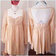 FREE PEOPLE SILK Bell Sleeve DRESS NWOT Gorgeous Hippy Princess peachy pink colored Silk dress by Free People Romantics. New without tags, ordered from free people so it came bagged not tagged. True to size. Bell sleeves, empire waist, babydoll style, open back.  Due to lighting- color of actual item may vary slightly from photos. No filters have been applied to alter or misrepresent color or condition.  I'm sorry but I do NOT trade Price is Firm Unless Bundled Act Like a Lady Free People…