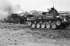 May 1967 - An amphibian tractor (also known as hit by mortars at Gio Linh, RVN, on the night of 9 May 67 is still burning the next morning. An Duster in foreground. Armored Fighting Vehicle, Us Marines, Vietnam War, Military History, Amphibians, Usmc, Military Vehicles, Tractors, Armour