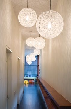 pretty lighting idea for long, narrow hallways