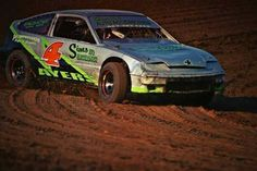 This is a 1991 Honda CRX dirt track race car. It is a point championship car around the area with a 1.5L and MSD Blaster Ignition. It currently comes with 6 Basset Racing rims and many (10+) stock sized rims with tires all mounted on them! We have many additional various parts that comes with the car with 2 crates full of ignition parts and manydifferent suspension parts... even doors and bumpers! This is a great package deal and is guaranteed to run up front at any track!