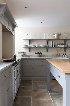The dual control AGA is positioned directly opposite a prep table in an original chimney with a bespoke overmantel concealing the extraction. Aga Kitchen, Prep Kitchen, Kitchen Pantry, Basement Kitchen, Rustic Kitchen Design, Farmhouse Style Kitchen, Kitchen Decor, Kitchen With High Ceilings, Country Kitchen Flooring
