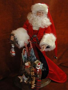 Bonnie Jones artist - Love this Santa and truly admire her talent.  This Santa has a patriotic flavor and a great flowing red robe.