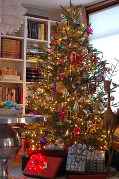 Christmas tree is decorated with antique ornaments. Want!