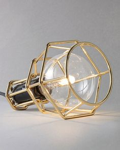 Design House Stockholm Work Lamp designed by Form Us With Love. Cage in 24K gold plate.