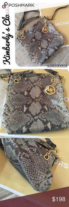 """🛍MICHAEL KORS🛍Jet Set Chain Crossbody Bag 💯% AUTHENTIC Beautiful MICHAEL KORS gray python embossed leather crossbody messenger bag.  Crossbody strap can be removed and can be carried as a shoulder tote - chain shoulder strap slides to be carried with double straps or one longer strap (see photos). 4 interior slip pockets and 1 zip pocket. Gold-tone chain and hardware. Measures 11.5"""" wide x 10.5"""" high x 3"""" deep.  Gently used - excellent condition. Michael Kors Bags Crossbody Bags"""