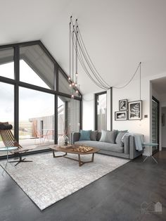 Interior of single storey pitched roof house with apex window and polished concrete floor. Visual by Matt Clayton.