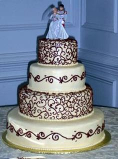 Unique Wedding Cakes | ... wedding cake for chocolate lovers topped with a traditional wedding