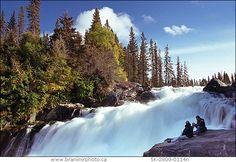Ten-metre high Nistowiak Falls on the Rapid River, as it flows into the Churchill River below Stanley Mission, Saskatchewan.