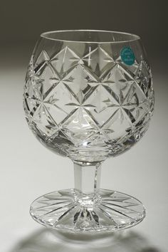 Tipperary Crystal Brandy Glass A crystal brandy glass in the Trellis pattern, designed by Sybil Connolly and manufactured by Tipperary Crystal in Ireland.