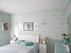 Bedroom with lotus wallpaper, wood works in pale powder and pavillon green and green blue walls.