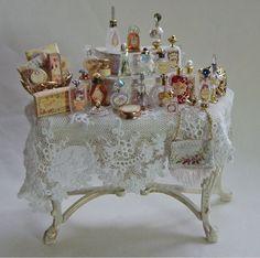 great display of vintage perfume bottles...love it...