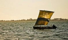 Dugout under-sail in the lagoon of Mussulo, Luanda , Angola.