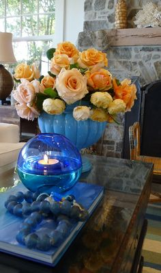 stunning peacock blue with orangey roses.  stunning!  slim paley blog, slim paley photo.