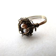 Hey, I found this really awesome Etsy listing at https://www.etsy.com/listing/99613306/birds-nest-ring-hummingbird-nest-pink    Love this ring...so cute!!
