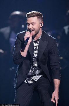 Typically dapper: The heartthrob looked typically dapper for the rendition wearing a black...