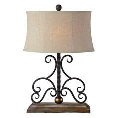 The Houston lamp has a unique look that blends industrial metal-like features with its feminine scroll design to give a formal look to a more casual body lamp. It features an oatmeal linen shade and wood-like base.