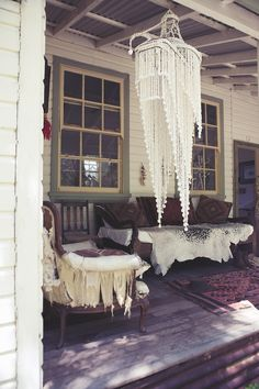 Rustic boho porch - LOVE LOVE that chandelier / wind chime ! what is it made out of I wonder...