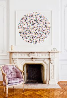 Omg perfect piece of art. Home Tour: A Legendary New York Townhouse via // Damien Hirst, marble fireplace, Louis chair Decoracion Vintage Chic, Home Decoracion, Mantel Styling, New York Townhouse, Interior Inspiration, Design Inspiration, Love Your Home, Fireplace Mantle, Fireplace Seating