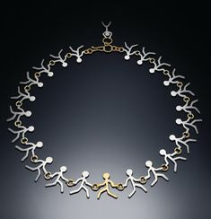 "Sterling and 14k Yellow Gold Necklace: ""Against the Current"""