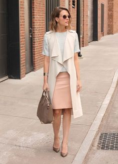 Kimberly Smith What I'm Wearing: H&M vest, Topshop top, Forever 21 skirt, Charles David pumps, Target sunglasses To Get My Look: A tough leather skirt looks instantly more feminine in a pastel hue. Click through to shop.
