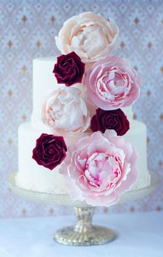 15 Marsala Wedding Details: Top your wedding cake with delicate sugar flowers like these from Lulu's Sweet Secrets.