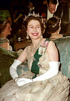1959. Party time: the Queen in a rare relaxed moment at the 16th/5th Royal Lancers' Ball, Hyde Park Hotel in 1959