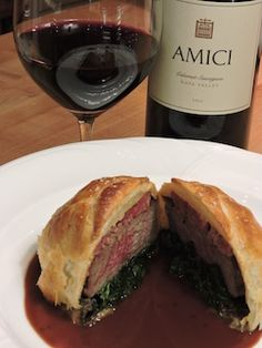 Beef Wellington with Cabernet Reduction Sauce.  Download this recipe at: http://www.amicicellars.com/news_and_events/recipes/beef_wellington.php This is an elegant dish with a presentation that makes it worthy of a special occasion.  The fine tannins and dark fruit flavors in the Amici Cabernet Sauvignon Napa Valley provide a lovely balance to the rich pastry, and layers of mushrooms and pâté in the Wellington highlight the earthy notes in the wine.