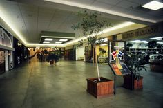 "Interior view of the Everett Mall, showing the Leg Room clothing store. The Everett Mall celebrated its grand opening on October 9, 1974. The mall was advertised as ""Snohomish County's first climate-controlled shopping center."" It boasted 550, 000 square feet of interior space and parking for 2, 800 cars.  Photo taken between 1975 and 1977."