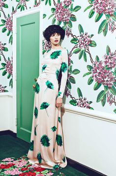 Floral dress with floral wall paper