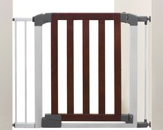 Munchkin Auto Close Modern Baby Gate, Dark Wood/Silver Metal, Model 46764 Stylish baby-proofing sounds like an oxymoron, but it's possible to find a hard