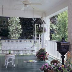 Interior accents like a ceiling fan and a shelf meant for potted plants offer an unexpected elegance to your patio.